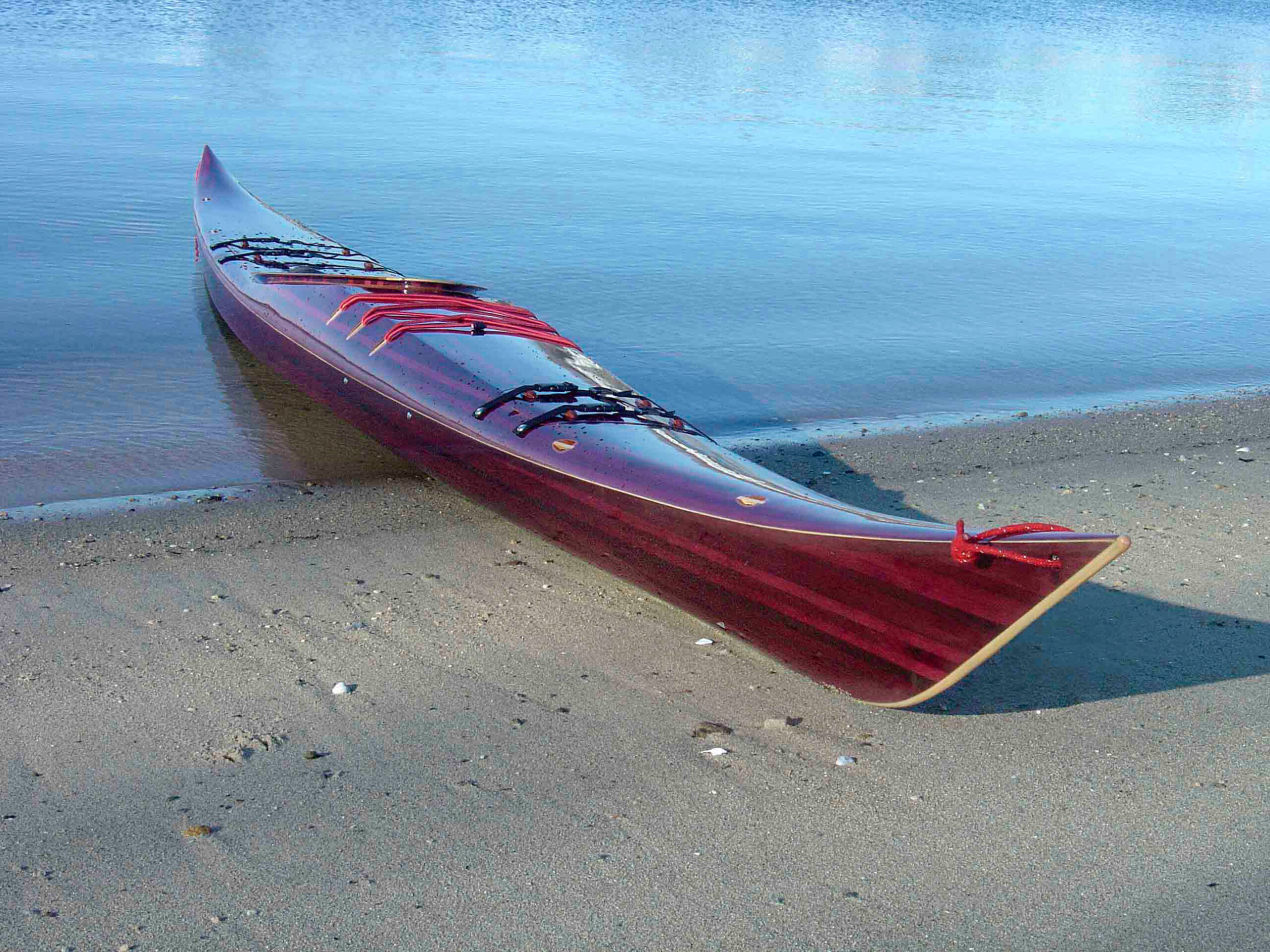 Strip built petrel sea kayak on the beach